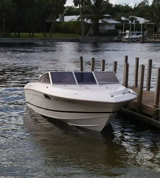 1986 SunRunner 20′ Boat, Rebuilt 185 HP Johnson, Alluminum Double Axel Trailer for sale